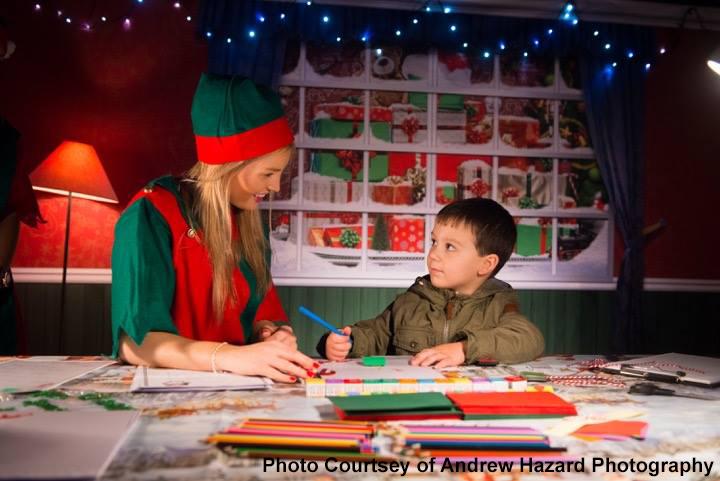Inside Santa's Post Office writing a letter